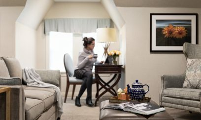 woman-relaxing-in-glidden-house-suite-321